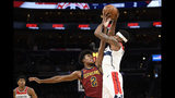 Cleveland Cavaliers guard Collin Sexton (2) fouls Washington Wizards guard Bradley Beal, right, during the first half of an NBA basketball game, Friday, Nov. 8, 2019, in Washington. (AP Photo/Nick Wass)