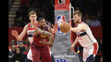 Cleveland Cavaliers center Tristan Thompson (13) passes the ball as Washington Wizards forward Moritz Wagner, back left, and forward Davis Bertans (42) defend during the first half of an NBA basketball game, Friday, Nov. 8, 2019, in Washington. (AP Photo/Nick Wass)