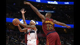 Washington Wizards guard Isaiah Thomas (4) goes to the basket past Cleveland Cavaliers center Tristan Thompson (13) during the first half of an NBA basketball game, Friday, Nov. 8, 2019, in Washington. (AP Photo/Nick Wass)