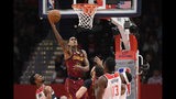 Cleveland Cavaliers guard Jordan Clarkson (8) goes to the basket past Washington Wizards guard Ish Smith, lower left, and center Thomas Bryant (13) during the first half of an NBA basketball game, Friday, Nov. 8, 2019, in Washington. (AP Photo/Nick Wass)