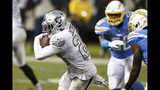 Oakland Raiders running back Josh Jacobs (28) heads toward the end zone to score against the Los Angeles Chargers during the second half of an NFL football game in Oakland, Calif., Thursday, Nov. 7, 2019. (AP Photo/D. Ross Cameron)