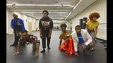 In this Thursday, Oct. 31, 2019 photo, students from the University of Georgia and Morehouse and Spelman colleges perform during their rehearsal about the state's history of convict labor at Spelman College's Wellness Center in Atlanta. A group of about two dozen students from the University of Georgia and Morehouse and Spelman colleges have teamed up to work on a performance about the state's history of convict labor. The first performance is scheduled for Friday, Nov. 8. The students are using stories from inmates who worked to build Georgia's railroads in state archives and interviews with current inmates to create the script for their performance. (Hyosub Shin/Atlanta Journal-Constitution via AP)