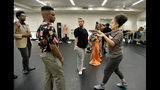 In this Thursday, Oct. 31, 2019 photo, Julie Johnson, senior lecturer, instructs students from the University of Georgia and Morehouse and Spelman colleges, who have teamed up to work on a performance about the state's history of convict labor, during their rehearsal at Spelman College's Wellness Center in Atlanta. The first performance is scheduled for Friday, Nov. 8. The students are using stories from inmates who worked to build Georgia's railroads in state archives and interviews with current inmates to create the script for their performance. (Hyosub Shin/Atlanta Journal-Constitution via AP)