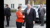 German Defense Minister Annegret Kramp-Karrenbauer, left, welcomes United States Secretary of State Mike Pompeo for a meeting at the defence ministry in Berlin, Germany, Friday, Nov. 8, 2019. (AP Photo/Markus Schreiber)