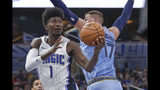 Orlando Magic's Jonathan Isaac (1) draws a foul from Memphis Grizzlies' Jonas Valanciunas (17) as he goes up to shoot during the first half of an NBA basketball game, Friday, Nov. 8, 2019, in Orlando, Fla. (AP Photo/John Raoux)