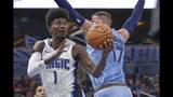 Orlando Magic's Jonathan Isaac (1) draws a foul from Memphis Grizzlies' Jonas Valanciunas (17) as he goes up to shoot during the first half of an NBA basketball game, Friday, Nov. 8, 2019, in Orlando, Fla. (AP Photo/John Raoux)