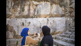 In this Thursday, Oct. 31, 2019 photo, Muslim women visits the Tomb of the Kings, a large underground burial complex dating to the first century BC, in east Jerusalem neighborhood of Sheikh Jarrah. After several aborted attempts, the French Consulate General has reopened one of Jerusalem's most magnificent ancient tombs to the public for the first time in over a decade, sparking a distinctly Jerusalem conflict over access to an archaeological-cum-holy site in the volatile city's eastern half. (AP Photo/Ariel Schalit)