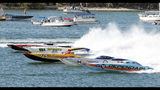 In this photo provided by the Florida Keys News Bureau, a portion of the Super Cat fleet lines up approaching the start line during the second day of racing at the Race World Offshore Key West Championships Friday, Nov. 8, 2019, in Key West, Fla. The finals of the series in the Florida Keys are set for Sunday, Nov. 10. (Rob O'Neal/Florida Keys News Bureau via AP)