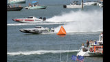 In this photo provided by the Florida Keys News Bureau, Performance Boat Center, left, piloted by Rusty Williams and Myrick Coil, and Shadow Pirate, operated by Nick Scafidi and Scott Porta, pass a turn buoy during the second day of racing at the Race World Offshore Key West Championships Friday, Nov. 8, 2019, in Key West, Fla. The finals of the series in the Florida Keys are set for Sunday, Nov. 10. (Rob O'Neal/Florida Keys News Bureau via AP)