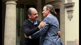 Federico Acosta, a Mexican who traces his lineage back 16 generations back to Moctezuma's daughter, left, embraces Italian Ascanio Pignatelli also of the 16th generation descended from Hernan Cortes' daughter, during a press conference in Mexico City, Friday, Nov. 8, 2019. Descendants of the Spanish conquistador and the Aztec emperor are meeting in Mexico City to mark the 500th anniversary of their forbearers' first encounter. The hope was that this meeting, at a colonial church where Cortes is buried, would go better than the one 500 years ago. (AP Photo/Eduardo Verdugo)
