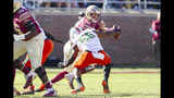 Florida State quarterback Alex Hornibrook (12) is sacked by Miami linebacker Michael Pinckney (56) in the first half of an NCAA college football game in Tallahassee, Fla., Saturday, Nov. 2, 2019. (AP Photo/Mark Wallheiser)