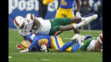 Miami linebacker Shaquille Quarterman (55) tackles Pittsburgh wide receiver Shocky Jacques-Louis (18) during the second half of an NCAA college football game, Saturday, Oct. 26, 2019, in Pittsburgh. Miami won 16-12. (AP Photo/Keith Srakocic)