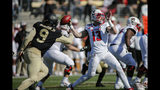 North Carolina State quarterback Devin Leary (13) looks to pass as Wake Forest Demon Deacons defensive lineman Carlos Basham Jr. (9) closes in the second half of an NCAA college football game in Winston-Salem, N.C., Saturday, Nov. 2, 2019. Wake Forest won 44-10. (AP Photo/Nell Redmond)