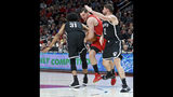 Portland Trail Blazers forward Mario Hezonja, center, dribbles between Brooklyn Nets center Jarrett Allen, left, and forward Joe Harris during the first half of an NBA basketball game in Portland, Ore., Friday, Nov. 8, 2019. (AP Photo/Craig Mitchelldyer)
