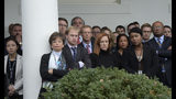 FILE - In this Wednesday, Nov. 9, 2016 file photo, staff members listen as President Barack Obama speaks about the presidential election results in the Rose Garden at the White House in Washington. On Friday, Nov. 8, 2019, The Associated Press reported on this AP photo circulating online accompanied by an incorrect identification of R. David Edelman as the whistleblower who led to the launch of the impeachment inquiry into President Donald Trump in 2019. Edelman left his position with the White House in 2017 before Trump's inauguration. (AP Photo/Susan Walsh, File)