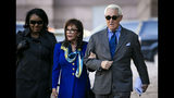 Roger Stone, and his wife Nydia, arrive at Federal Court for his federal trial in Washington, Friday, Nov. 8, 2019. (AP Photo/Al Drago)