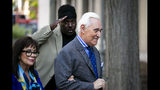 Roger Stone, and his wife Nydia, arrive as a man salutes him at Federal Court for his federal trial in Washington, Friday, Nov. 8, 2019. (AP Photo/Al Drago)