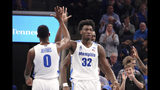 Memphis' James Wiseman (32) is congratulated by D.J. Jeffries (0) during the first half of an NCAA college basketball game against South Carolina State on Tuesday, Nov. 5, 2019, in Memphis, Tenn. (AP Photo/Karen Pulfer Focht)