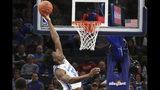 Memphis' James Wiseman (32) dunks against South Carolina State during the first half of an NCAA college basketball game Tuesday, Nov. 5, 2019, in Memphis, Tenn. (AP Photo/Karen Pulfer Focht)
