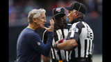 Seattle Seahawks head coach Pete Carroll speaks to back judge Perry Paganelli (46) during the second half of an NFL football game against the Atlanta Falcons, Sunday, Oct. 27, 2019, in Atlanta. (AP Photo/John Bazemore)