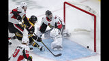 Boston Bruins right wing David Pastrnak (88) beats Ottawa Senators goaltender Craig Anderson (41) for a goal during the first period of an NHL hockey game in Boston, Saturday, Nov. 2, 2019. (AP Photo/Charles Krupa)