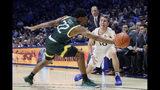 Xavier guard Leighton Schrand (10) passes the ball around Siena guard Jalen Pickett (22) during the first half of an NCAA college basketball game Friday, Nov. 8, 2019, in Cincinnati. (AP Photo/John Minchillo)