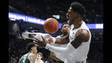 Xavier's Tyrique Jones (4) reacts after dunking during the first half of the team's NCAA college basketball game against Siena, Friday, Nov. 8, 2019, in Cincinnati. (AP Photo/John Minchillo)