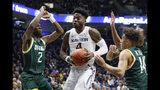 Xavier's Tyrique Jones (4) drives against Siena's Gary Harris Jr. (2) and Jordan King (14) during the first half of an NCAA college basketball game Friday, Nov. 8, 2019, in Cincinnati. (AP Photo/John Minchillo)