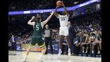 Xavier's Naji Marshall (13) shoots over Siena's Matt Hein (5) during the first half of an NCAA college basketball game Friday, Nov. 8, 2019, in Cincinnati. (AP Photo/John Minchillo)