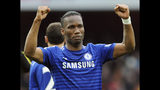 FILE - In this Sunday, April 26, 2015 file photo, Chelsea's Didier Drogba during the English Premier League soccer match between Arsenal and Chelsea at the Emirates Stadium, London, England. The international soccer players now studying on an executive masters course could field one of the best school teams ever seen. After classes this week, Ballon d'Or winner Kaka was joined on the field by Champions League winners Florent Malouda and Julio Cesar and an array of one-time national team stars. Didier Drogba, though not playing, and Andriy Arshavin are also classmates for an 18-month education now in its third edition. (AP Photo/Rui Vieira, file)