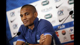 FILE - In this Wednesday, June 20, 2012 file photo, France's Florent Malouda attends a press conference prior to a Euro 2012 soccer quarterfinal match in Donetsk, Ukraine. The international soccer players now studying on an executive masters course could field one of the best school teams ever seen. After classes this week, Ballon d'Or winner Kaka was joined on the field by Champions League winners Florent Malouda and Julio Cesar and an array of one-time national team stars. Didier Drogba, though not playing, and Andriy Arshavin are also classmates for an 18-month education now in its third edition. (AP Photo/Laurent Cipriani)
