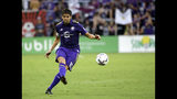 FILE - In this Friday, July 21, 2017 file photo, Orlando City's Kaka takes a free kick against Atlanta United in Orlando, Fla. The international soccer players now studying on an executive masters course could field one of the best school teams ever seen. After classes this week, Ballon d'Or winner Kaka was joined on the field by Champions League winners Florent Malouda and Julio Cesar and an array of one-time national team stars. Didier Drogba, though not playing, and Andriy Arshavin are also classmates for an 18-month education now in its third edition. (AP Photo/John Raoux, file)