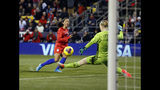 United States forward Christen Press, left, scores past Sweden goalkeeper Hedvig Lindahl during the first half of a women's international friendly soccer match in Columbus, Ohio, Thursday, Nov. 7, 2019. (AP Photo/Paul Vernon)