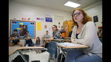 Tenth-grader Emma Preston listens intently during civics class at Chatham Central High School in Bear Creek, N.C., on Tuesday, Nov. 5, 2019. The class is debating whether President Trump should be impeached. The House impeachment inquiry into Trump's dealings with Ukraine has become a teachable moment in classrooms around the country as educators incorporate the events in Washington into their lesson plans.(AP Photo/Allen G. Breed)