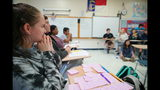 Kaylee Maness listens to arguments during civics class at Chatham Central High School in Bear Creek, N.C., on Tuesday, Nov. 5, 2019. The 10th-grader had begun the class undecided about whether President Trump should be impeached, but later joined the pro-impeachment side. The House impeachment inquiry into Trump's dealings with Ukraine has become a teachable moment in classrooms around the country as educators incorporate the events in Washington into their lesson plans. (AP Photo/Allen G. Breed)