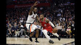 Portland Trail Blazers' Damian Lillard (0) dribbles next to Los Angeles Clippers' Kawhi Leonard (2) during the first half of an NBA basketball game Thursday, Nov. 7, 2019, in Los Angeles. (AP Photo/Marcio Jose Sanchez)