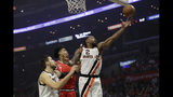 Los Angeles Clippers' Kawhi Leonard (2) grabs a rebound in front of Portland Trail Blazers' Hassan Whiteside, center, during the first half of an NBA basketball game Thursday, Nov. 7, 2019, in Los Angeles. (AP Photo/Marcio Jose Sanchez)
