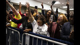 """Supporters of President Donald Trump cheer as he arrives to speak during the launch of """"Black Voices for Trump,"""" at the Georgia World Congress Center, Friday, Nov. 8, 2019, in Atlanta. (AP Photo/ Evan Vucci)"""