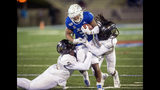 Tulsa running back Shamari Brooks, center, is tackled by Central Florida linebacker Eric Mitchell, left, and defensive back Aaron Robinson during an NCAA college football game, Friday, Nov. 8, 2019 in Tulsa, Okla. (Brett Rojo/Tulsa World via AP)