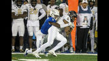 Tulsa cornerback Reggie Robinson II (9) tackles Central Florida wide receiver Gabriel Davis during the first half of an NCAA college football game, Friday, Nov. 8, 2019 in Tulsa, Okla. (Brett Rojo/Tulsa World via AP)