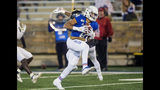 Tulsa wide receiver Keenen Johnson makes a reception in front of Central Florida defensive back Jordan Hayes for a touchdown during an NCAA college football game, Friday, Nov. 8, 2019 in Tulsa, Okla. (Brett Rojo/Tulsa World via AP)