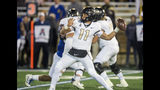 Central Florida quarterback Dillon Gabriel (11) throws a pass during an NCAA college football game against Tulsa, Friday, Nov. 8, 2019 in Tulsa, Okla. (Brett Rojo/Tulsa World via AP)