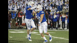 Tulsa linebacker Mitchell Kulkin (40) celebrates his open field tackle with linebacker Grant Sawyer during the second half of an NCAA college football game against Central Florida, Friday, Nov. 8, 2019 in Tulsa, Okla. (Brett Rojo/Tulsa World via AP)