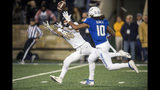 Central Florida wide receiver Tre Nixon (16) makes a reception as Tulsa safety Manny Bunch defends during the first half of an NCAA college football game, Friday, Nov. 8, 2019 in Tulsa, Okla. (Brett Rojo/Tulsa World via AP)