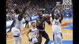UNC Greensboro's Isaiah Miller (1) shoots between Kansas' Udoka Azubuike (35) and Marcus Garrett (0) during the first half of an NCAA college basketball game Friday, Nov. 8, 2019, in Lawrence, Kan. (AP Photo/Charlie Riedel)