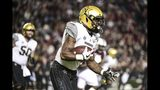 Vanderbilt running back Ke'Shawn Vaughn (5) caries the ball during the first half of an NCAA college football game against South Carolina, Saturday, Nov. 2, 2019, in Columbia, S.C. (AP Photo/Sean Rayford)