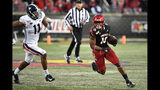 Louisville running back Javian Hawkins (10) runs from the pursuit of Virginia linebacker Charles Snowden (11) during the second half of an NCAA college football game in Louisville, Ky., Saturday, Oct. 26, 2019. Louisville won 28-21. (AP Photo/Timothy D. Easley)