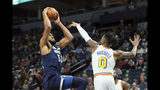 Minnesota Timberwolves' Karl-Anthony Towns, left, as Golden State Warriors' D'Angelo Russell defends in the first half of an NBA basketball game Friday, Nov 8, 2019, in Minneapolis. (AP Photo/Jim Mone)