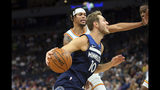 Minnesota Timberwolves' Jake Layman (10) drives around Golden State Warriors' Damion Lee in the first half of an NBA basketball game Friday, Nov 8, 2019, in Minneapolis. (AP Photo/Jim Mone)