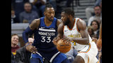 Golden State Warriors' Eric Paschall, right, drives around against the Minnesota Timberwolves' Minnesota Timberwolves' Robert Covington in the first half of an NBA basketball game Friday, Nov 8, 2019, in Minneapolis. (AP Photo/Jim Mone)